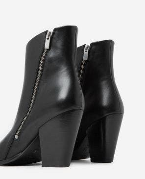 Black heeled ankle boots with pointed toes