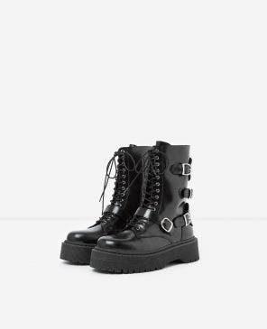 Glossy laced buckled black leather boots