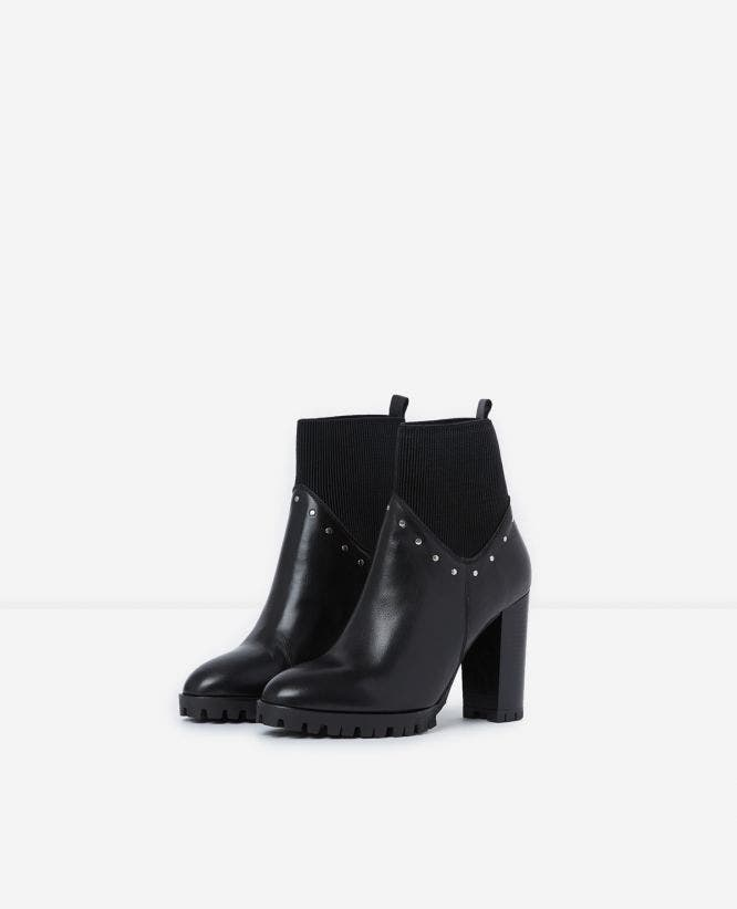 Black heeled ankle boots with studs