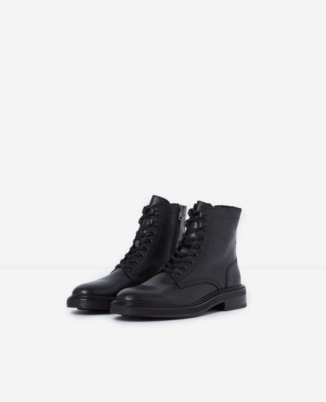 Biker style black leather ankle boots