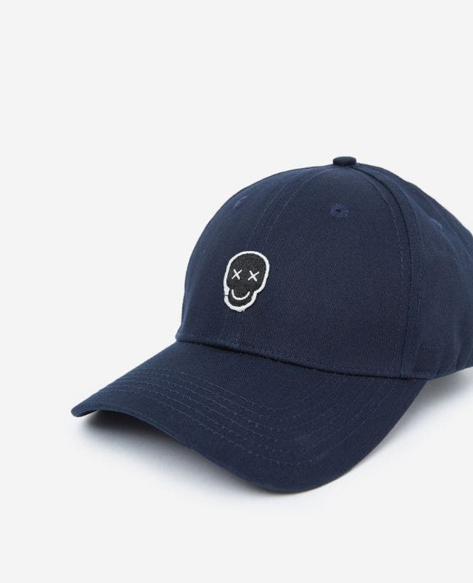 Blue cotton cap with Happy Skull badge