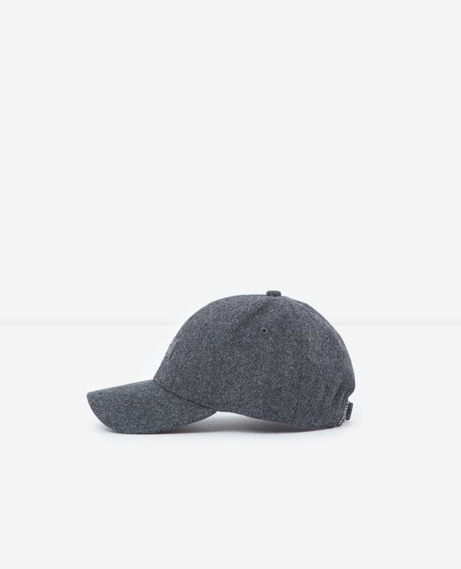 Adjustable grey flannel cap with badge