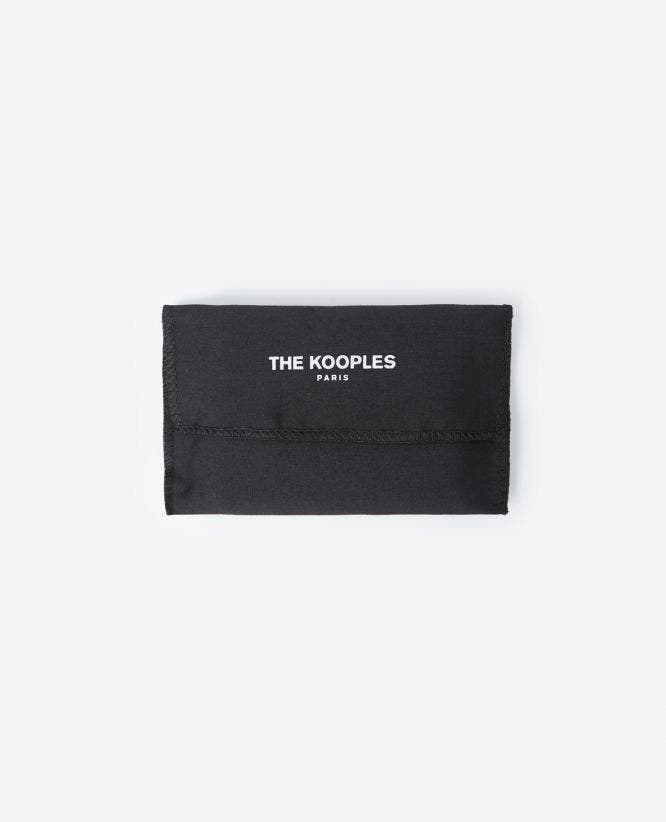 Black leather card holder with metal tag