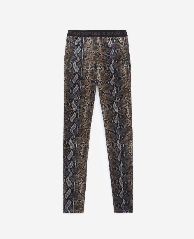 Stretchy printed joggers with snake print