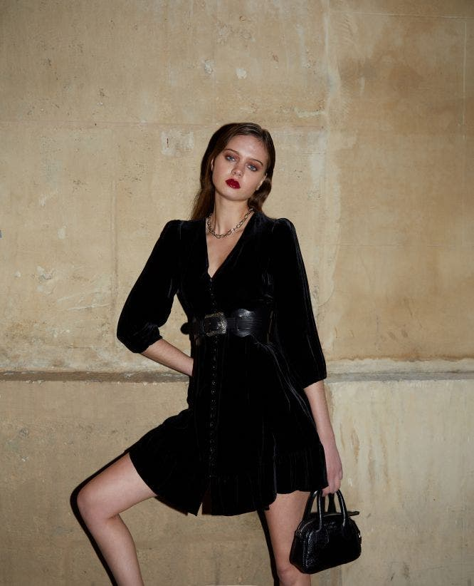 Cropped black rock-style velvet dress