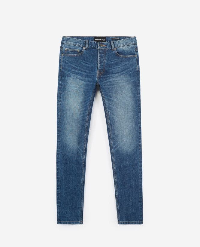 Raw blue jeans with five pockets