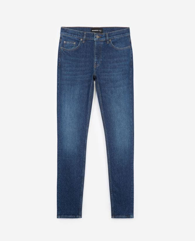 Dark blue slim jeans with leather pocket