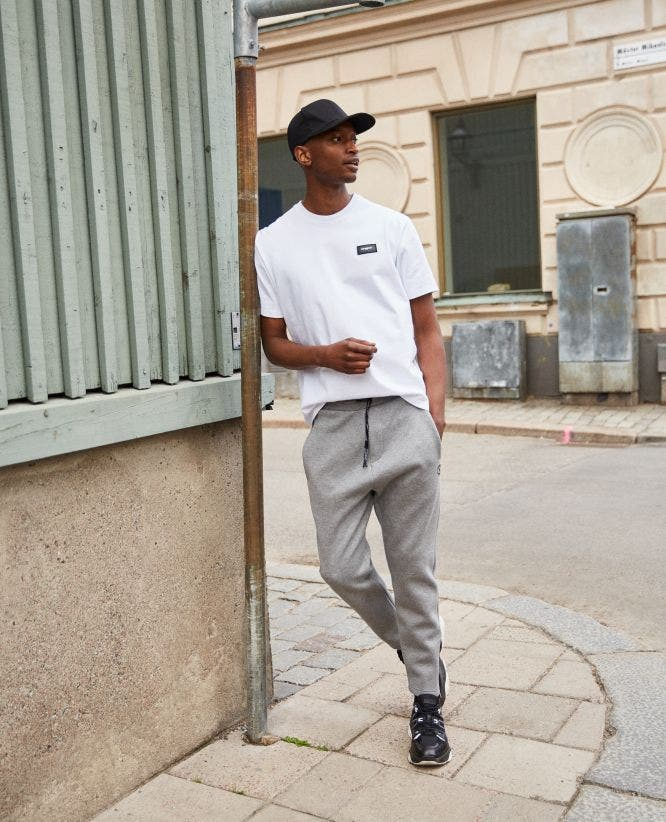 Zipped gray cotton joggers with rubber logo