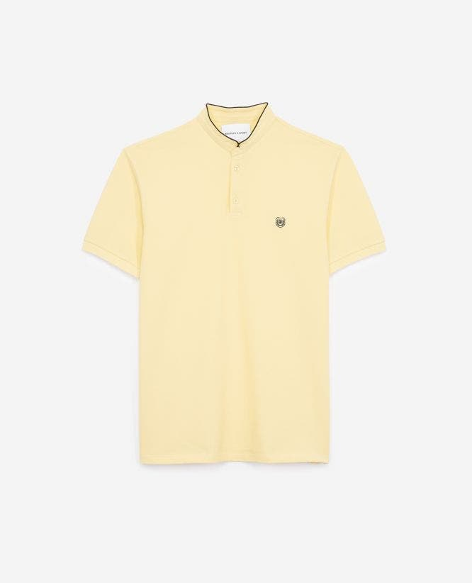 Fitted beige polo shirt with stand-up collar