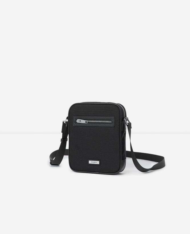 Black dual-material satchel logo plaque pockets