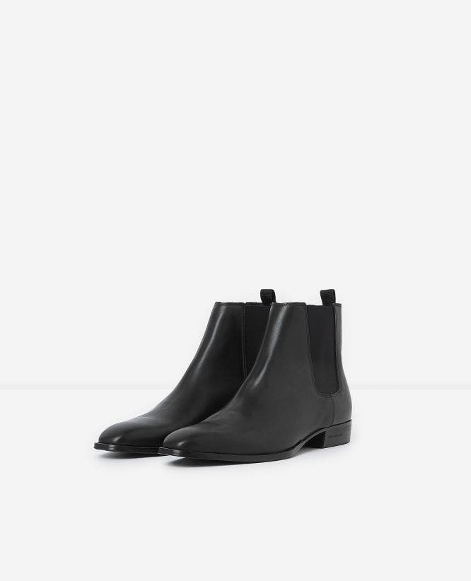 Flat black leather chelsea boots