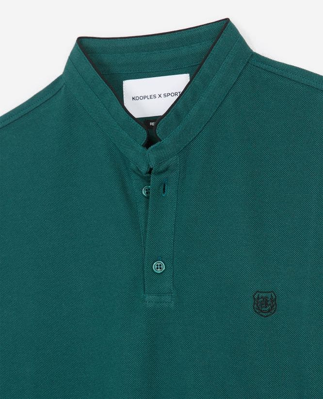 Embroidered green polo, officer collar, badge