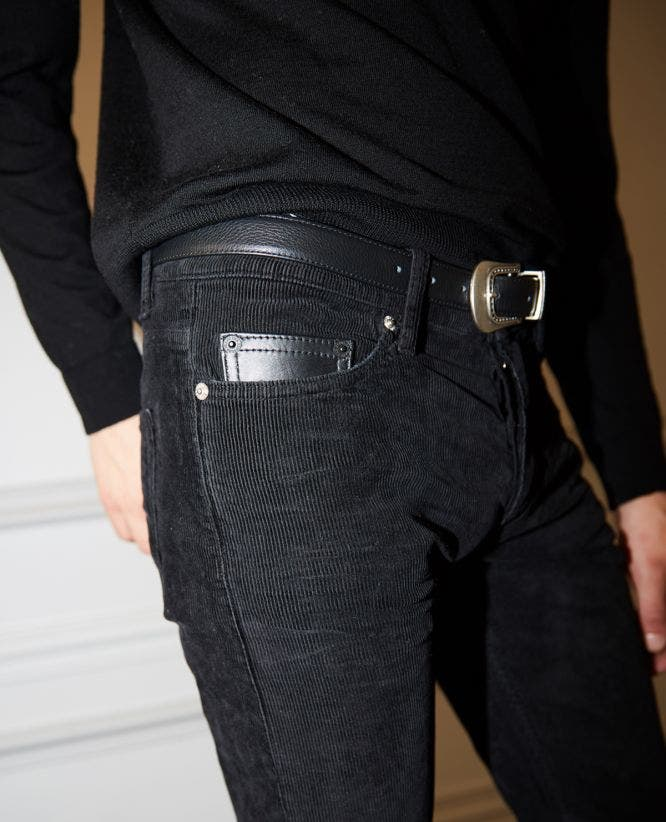 Black corduroy jeans with tack buttons