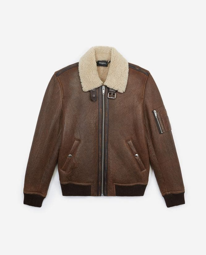 Flight-style brown leather jacket