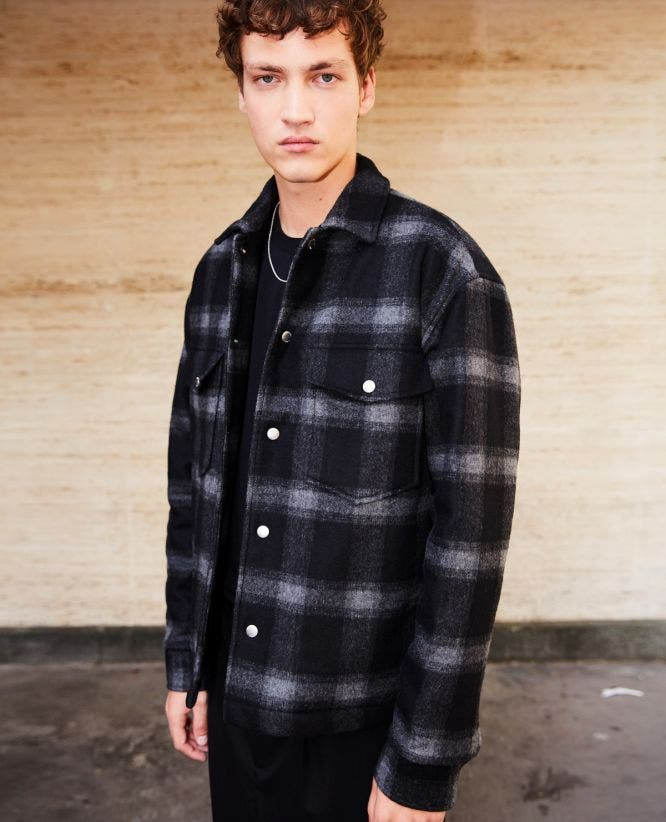 Buttoned black wool jacket with check motif
