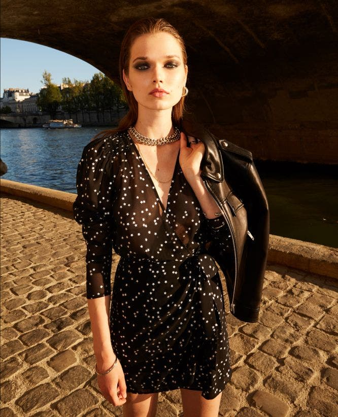 Short black dress with shoulder pads & stars
