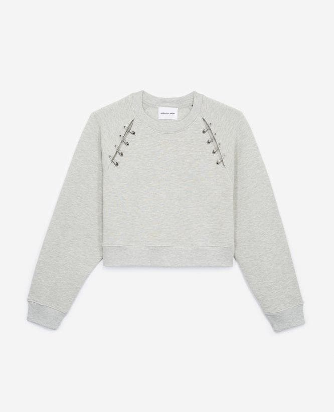 Grey sweatshirt with opening and pins
