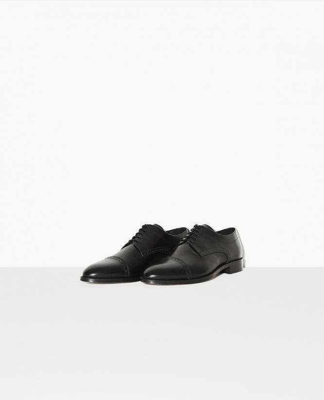 Classic brogues in mat leather
