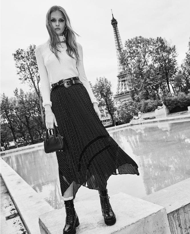 Long pleated skirt with polka-dot print