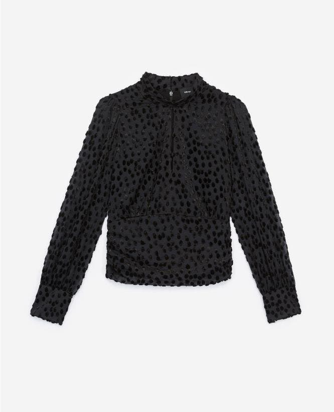 Black high-neck top with tone-on-tone dots