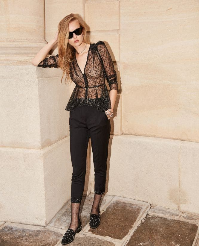 Flowing black trousers with studs