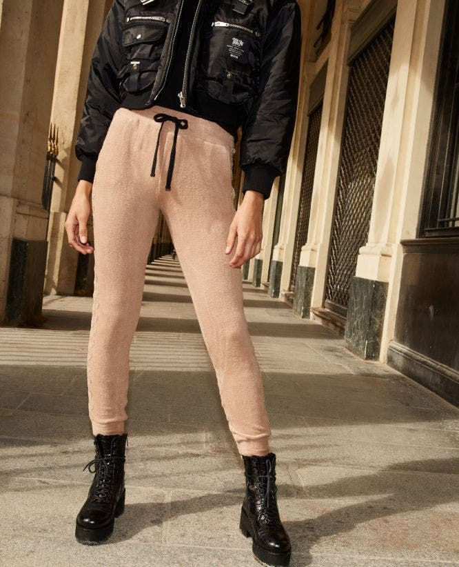 Camel-coloured joggers with lace at the side