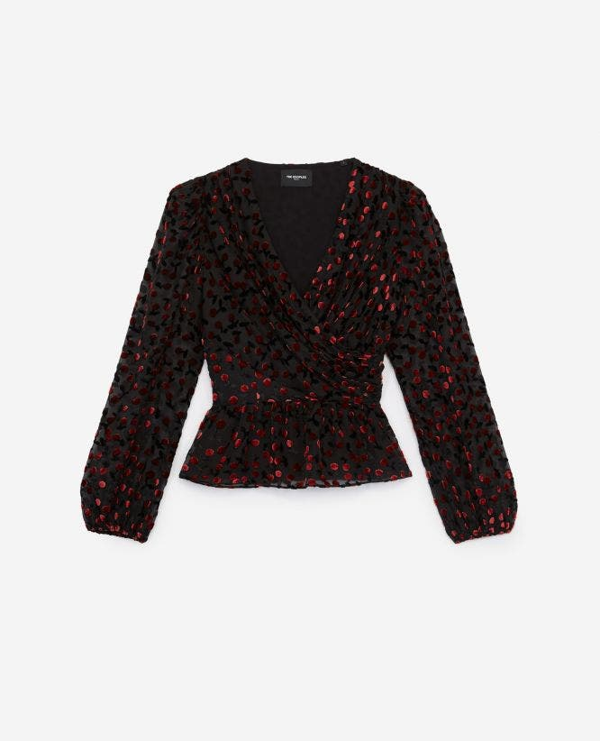 Draped long-sleeve black top with motif