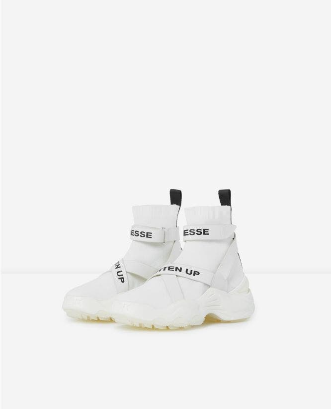 Slick white high-top trainers with text