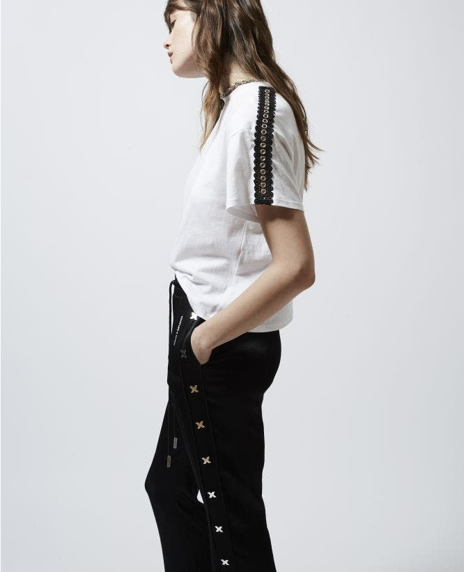 Loose-fitting white T-shirt with eyelets